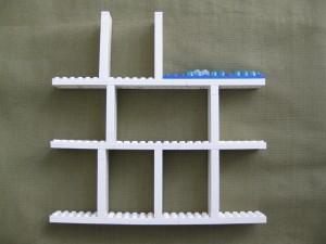 En enkel byggställning av LEGO som platsar i ramen. Rutornas storlek varieras efter smak.