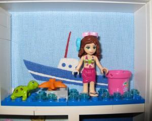 Lata dagar vid stranden med Olivia. Lilla sköldpaddan hänger gärna med på en tur i båten.
